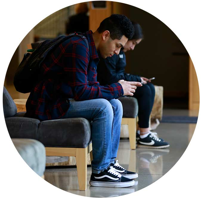 WOU student on their phone