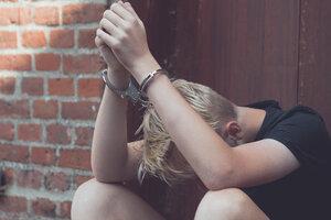 juvenile in handcuffs
