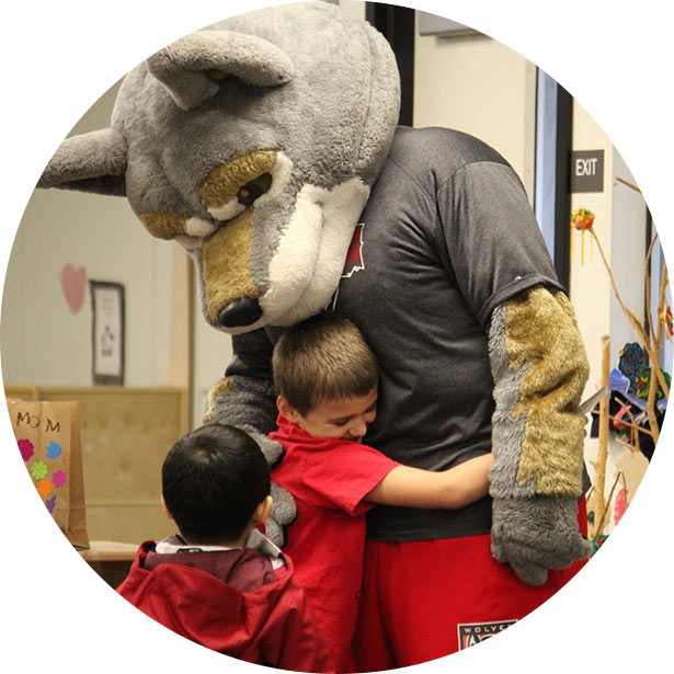 Wolfie hugging a boy