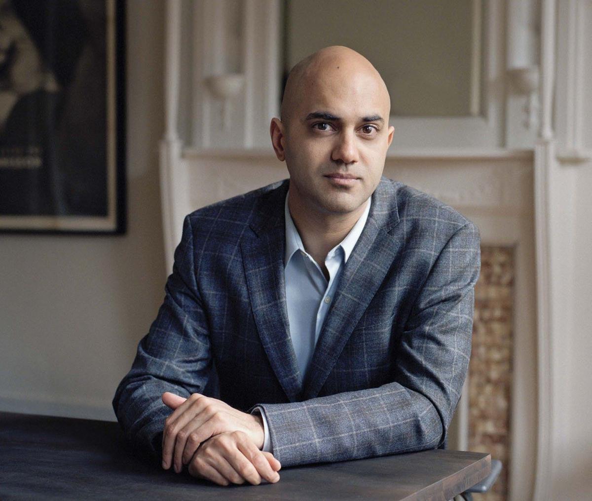 Jensen Lecture Series 2019 Speaker Ayad Akhtar, sitting at a desk