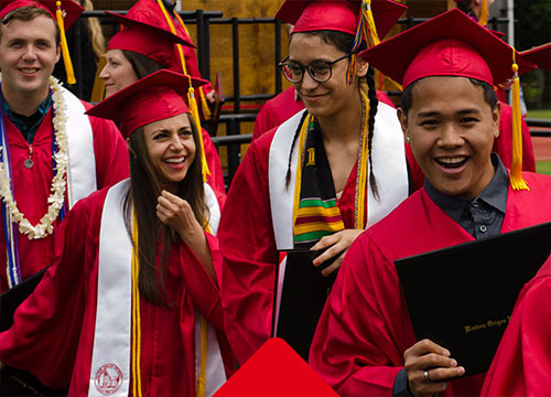 WOU graduates excitedly walking