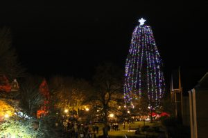 View of WOU Holiday Tree Lighting and crowd around lit tree