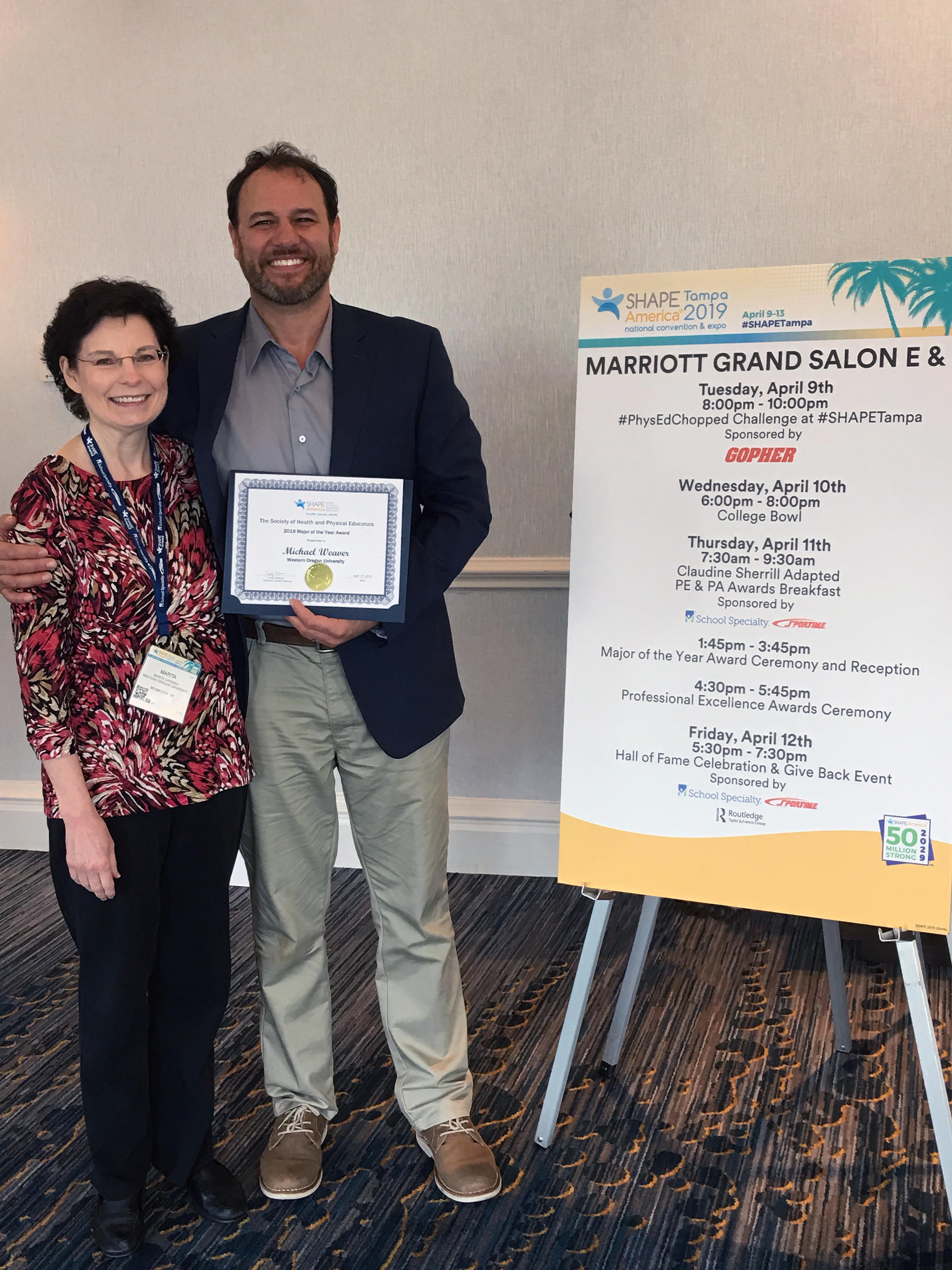 "HEXS professor Dr. Marita Cardinal and ""Major of the Year"" Michael Weaver."