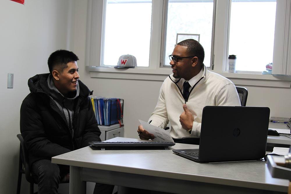 WOU advisor helping student