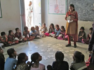 Meeta, a Team Balika member, engaging in the Creative Learning Technique with young students