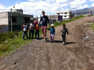 Walking kids from the market to the UBECI area.