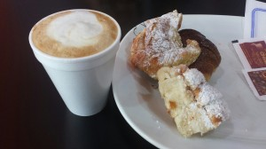 This is a picture of the facturas (pastries)  and coffee I had with my roommate.