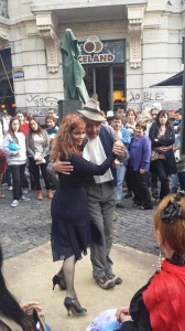 A picture of a lovely couple dancing to some tango in the streets on San Telmo.